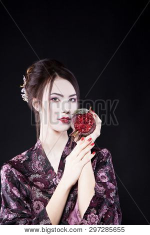 Attractive Asian girl in the image of a geisha. Beauty, fashion, portrait