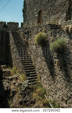Stone Staircase Going Up The Wall With Merlons And Squared Tower, On A Sunny Day At The Castle Of Po