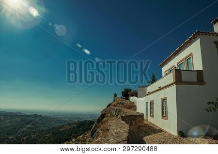 Old House And Stone Breastwork Over Ridge, With Mountainous Landscape On Sunny Day At Marvao. An Ama