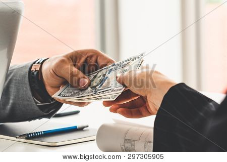 Businessman Hand Sending Money To Another Business Person. Transaction, Payment, Salary And Banking