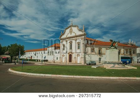 Estremoz, Portugal - July 06, 2018. Street roundabout with monument and building in baroque style at Estremoz. A nice little historic town with several buildings made of marble on eastern Portugal.