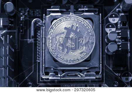 Silver bitcoin on the microprocessor, closeup, bw background. Business concept of digital bitcoin cryptocurrency. Blockchain technology, bitcoin mining concept