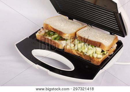 Closeview, Sandwich Toaster With Toast And Ingredients