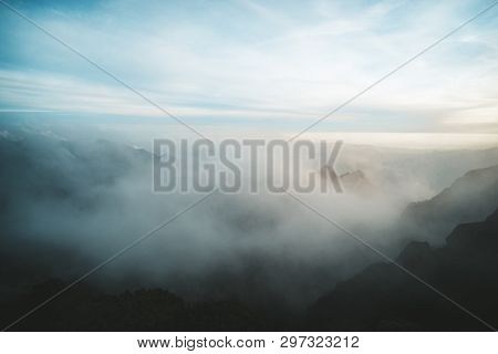 Mountain Range With Visible Silhouettes Through The Morning Fog. Beautiful Mountain Landscape From A