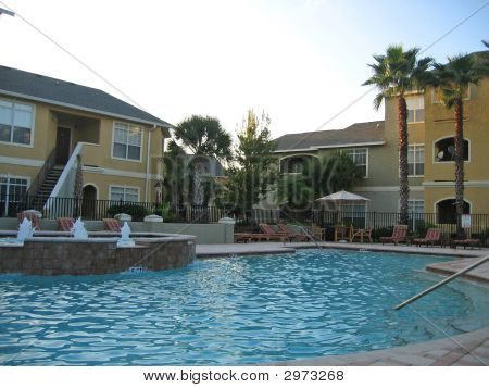 Outdoor Pool In The Middle Of Modern Condo Complex
