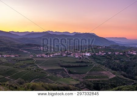Small Village Kojsko With Chirch Križ On The Hill On Sunrise Between The Vineyards In The Wine Regio