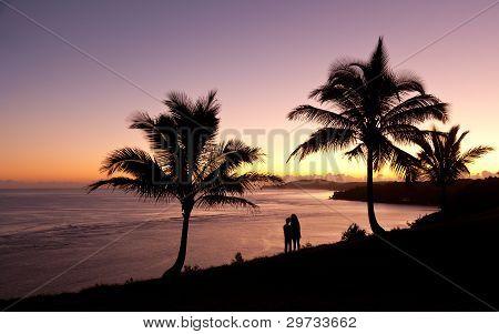Couple Watching Sunrise In Kauai