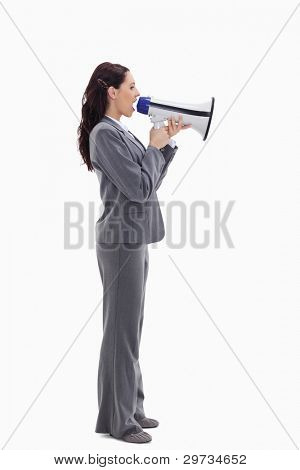 Profile of a businesswoman speaking loudly in a megaphone against white background