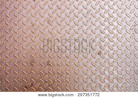 An image of a rusty diamond metal plate background