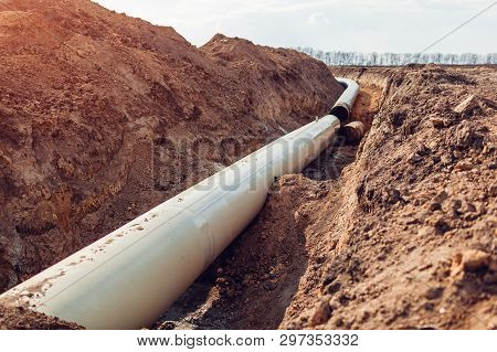 Industrial Gas Pipeline. Laying New Pipes In Field Underground