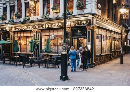 London, Uk - April 13, 2019: People Entering Sherlock Holmes Pub In London, A Traditional English Pu
