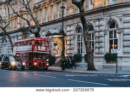 London, Uk - April 13, 2019: Black Cab And An Afternoon Tea Bus Tour Inside Retro Red Double Decker