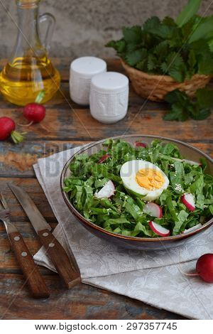 Vitamin Salad From Lettuce, Radish, Green Onions And Eggs, Seasoned With Vegetable Oil In Plate On W