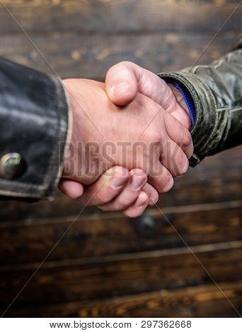 Shaking Hands Close Up. Handshake Friendly Gesture. Handshake Gesture Concept. Partnership And Busin