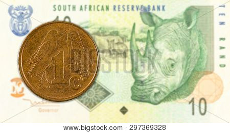 1 South African Aforika Coin Against 10 South African Rand Banknote