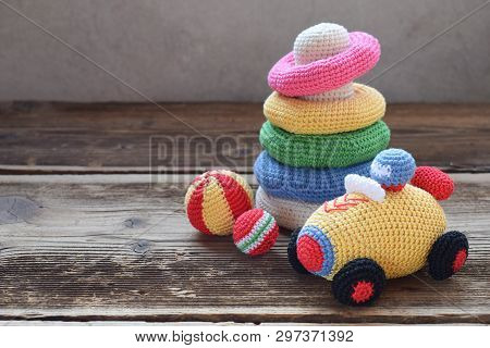 Colored Crochet Racing Car And Pyramid From Colored Rings. Toy For Babies And Toddlers To Learn Mech