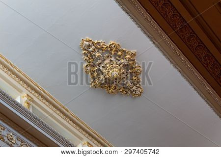 Elaborate ceiling medallion of cast plaster and gold leaf, beautiful cornice and frieze work, horizontal aspect poster