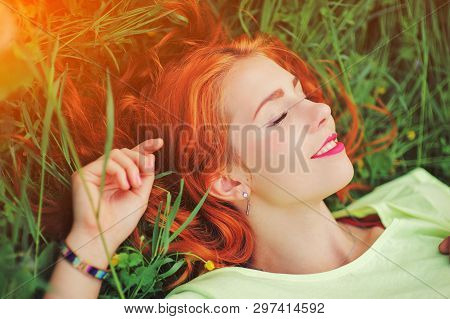 Attractive Beautiful Young Red Hair Woman Outdoors Enjoy Summer Nature. Cheerful Healthy Smiling Hap