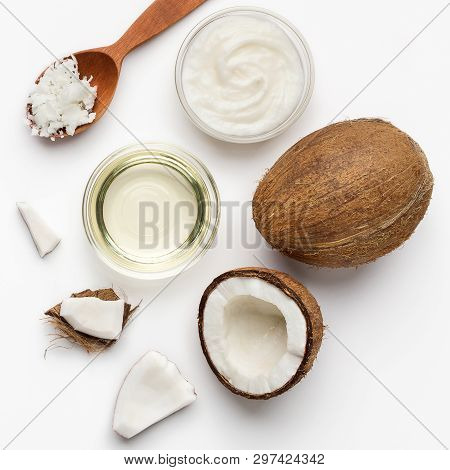 Fresh Chopped Coconuts, Coco Flesh And Bowls Of Coconut Oil On White Background, Top View. Coconut B