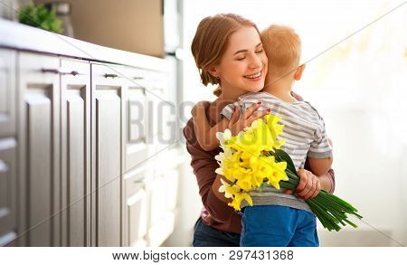Happy Mother's Day! Child Son Gives Flowersfor  Mother On Holiday .