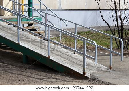A Wheelchair Ramp, An Inclined Plane Installed In Addition To Or Instead Of Stairs.