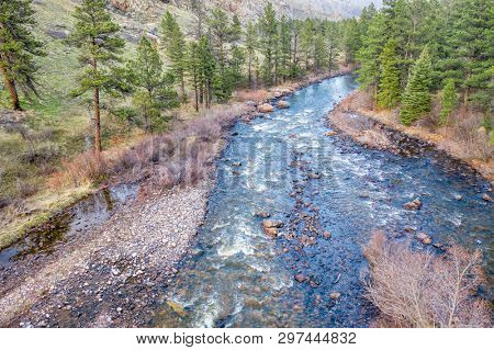 mountain river in early spring, aerial view of the Poudre River in northern Colorado