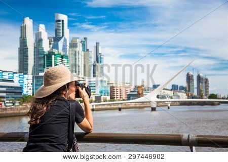 Buenos Aires Argentina - Dec 27, 2018:Beautiful young woman take a photos of  Puerto Madero district on suny day in Buenos Aires, Argentina.
