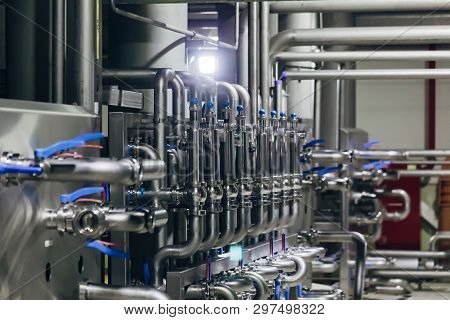 Industrial Stainless Steel Pipes Connected With Vats And Control Valves.
