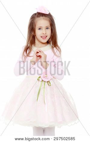 Dressy Little Girl Long Blonde Hair, Beautiful Pink Dress And A Rose In Her Hair.she Folded Her Arms