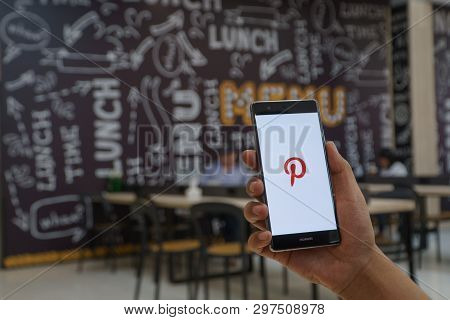 Chiang Mai, Thailand - Jan. 06,2019: Man Holding Huawei Mobile Phone With Pinterest Apps Login On Sc