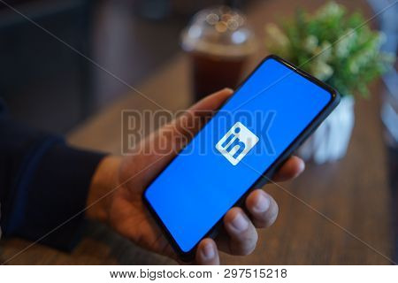 Chiang Mai, Thailand - Mar. 24,2019: Man Holding Xiaomi Mi Mix 3 Mobile Phone With Linkedin Applicat