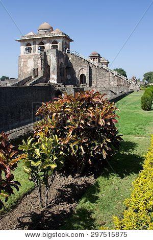 View Of Ship Palace Or Jahaz Mahal At Mandu With Garden Foliage In Foreground, Madhya Pradesh, India