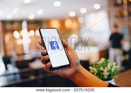 Chiang Mai, Thailand - Mar. 24,2019: Man Holding Xiaomi Mi Mix3 With Facebook App On The Screen. Fac