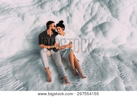Loving Couple In The Arms. Man And Woman Hugging On White Background. Stylish Couple In Love. Newly