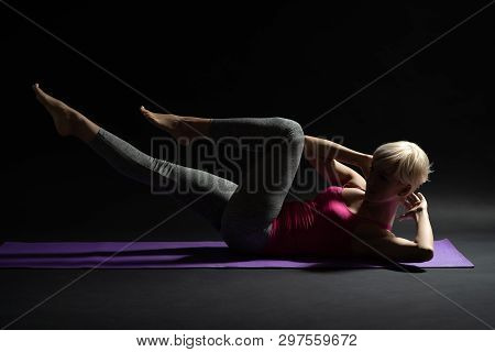 Woman Exercising Pilates. Criss Cross Exercise. Studio Shot.