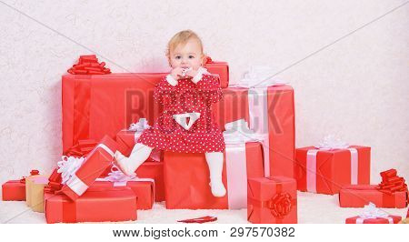 Little Baby Girl Play Near Pile Of Gift Boxes. Baby First Christmas Once In Lifetime Event. Family H
