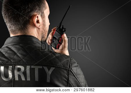 The Man, Security, Is Holding A Walkie-talkie. The Concept Of Protection, Protection Of Information,