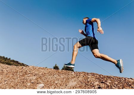 Athlete Runner Run Uphill Trail On Blue Sky Background