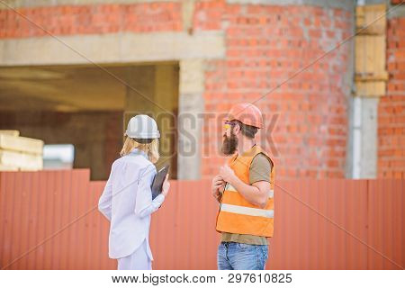 Construction Site Safety Inspection. Discuss Progress Project. Safety Inspector Concept. Woman Inspe