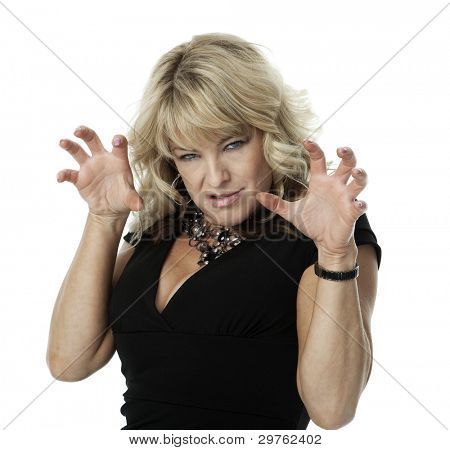 Mid-adult blond woman with angry expression and hands raised in claw-like gesture, on white background.