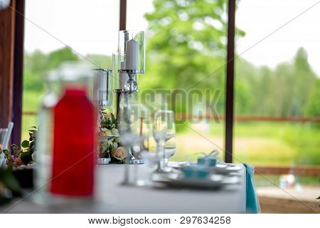 Wedding Table Decoration. Candlestick With Candles And Dishes On The Table. Candles In Candlestick S