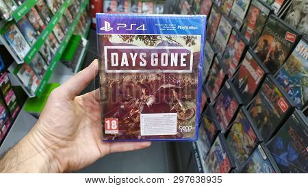 Bratislava, Slovakia, April 25, 2019: Man Holding Days Gone Videogame On Sony Playstation 4 Console