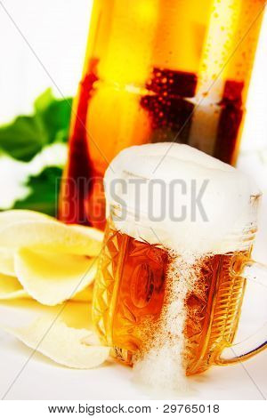Glass Of Beer On The Background Of A Plastic Bottle