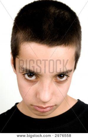 Teenage Boy With Big Brown Eyes Looking Sad