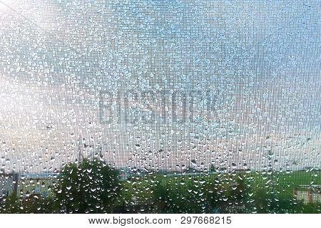Rain Outside Window Raindrops On Windowpane In Summer Day