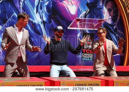 LOS ANGELES - APR 23:  Chris Hemsworth, Chris Evans, Robert Downey Jr at the Avengers Cast Members Handprint Ceremony at the TCL Chinese Theater on April 23, 2019 in Los Angeles, CA