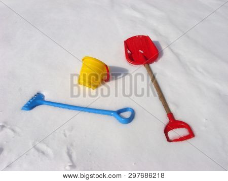 Kids Winter Play Objects. Bucket, Rake And Shovel On A Snow