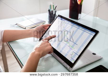 Businessperson Analyzing Gantt Chart On Laptop