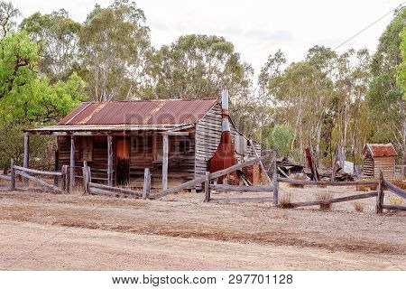 An Old Abandoned Falling Down Timber Slab Hut With Iron Roof Disused In The Australian Countryside