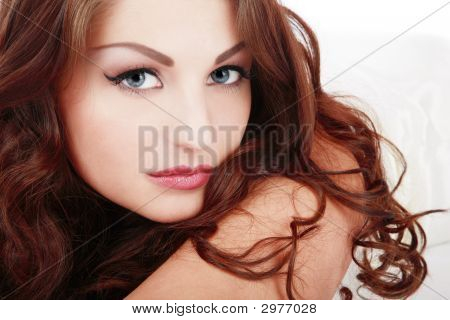 Portrait of beautiful blue-eyed girl with curling hair poster
